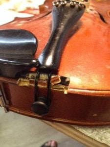 Broken violin saddle